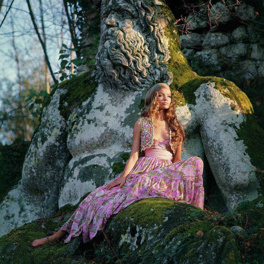 Veruschka Von Lehndorff Sitting On A Sculpture Photograph by Franco Rubartelli