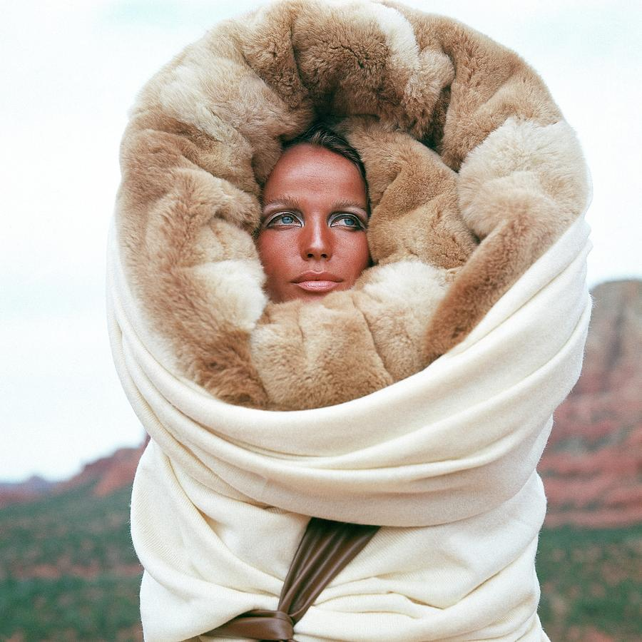 Veruschka Von Lehndorff Wearing A Fur Wrap Photograph by Franco Rubartelli