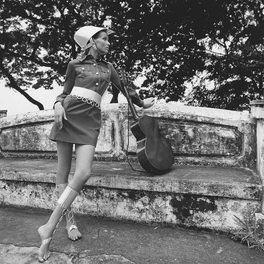 Veruschka Von Lehndorff Wearing A Shirtdress Photograph by Franco Rubartelli