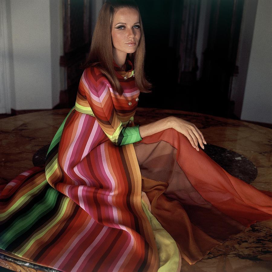 Veruschka Von Lehndorff Wearing A Striped Coat Photograph by Henry Clarke