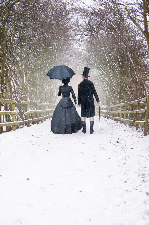 Victorian Couple Walking In Snow Photograph By Lee Avison