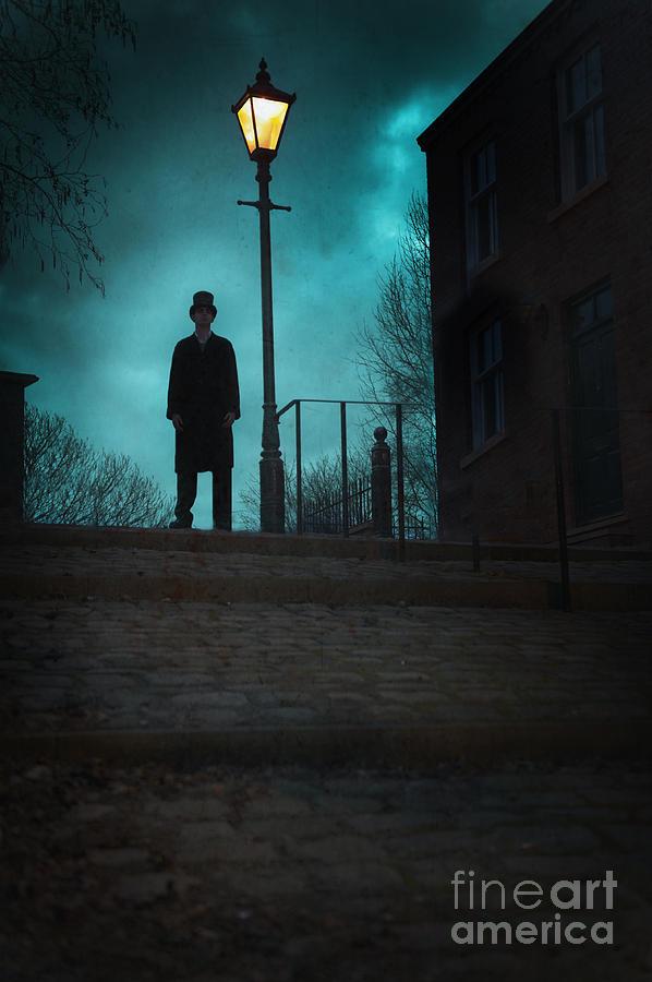 Victorian Man Standing Under An Old Gas Street Light