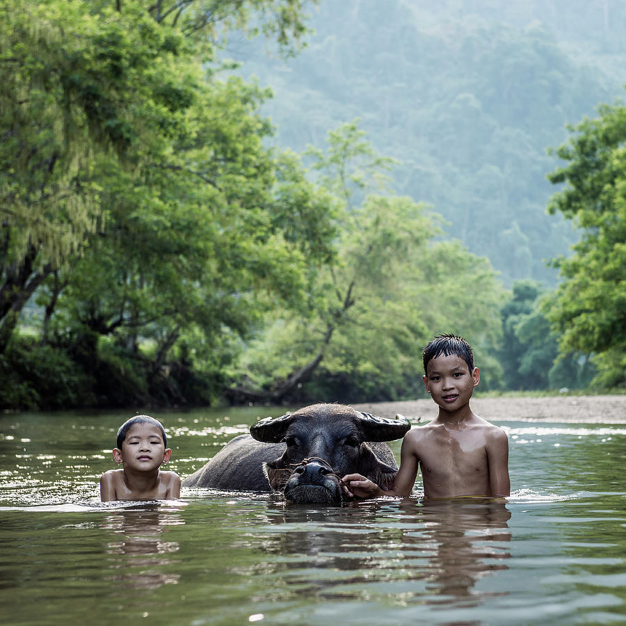 Vietnam, Young Boys In River With Water Photograph by Martin Puddy