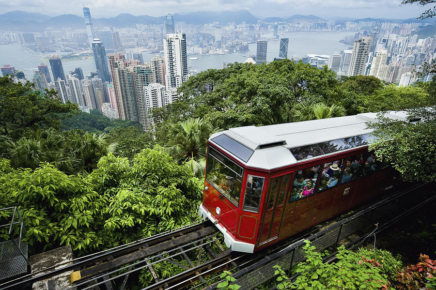 Architecture Photograph - View Of Peak Tram Arriving At The Top by Axiom Photographic