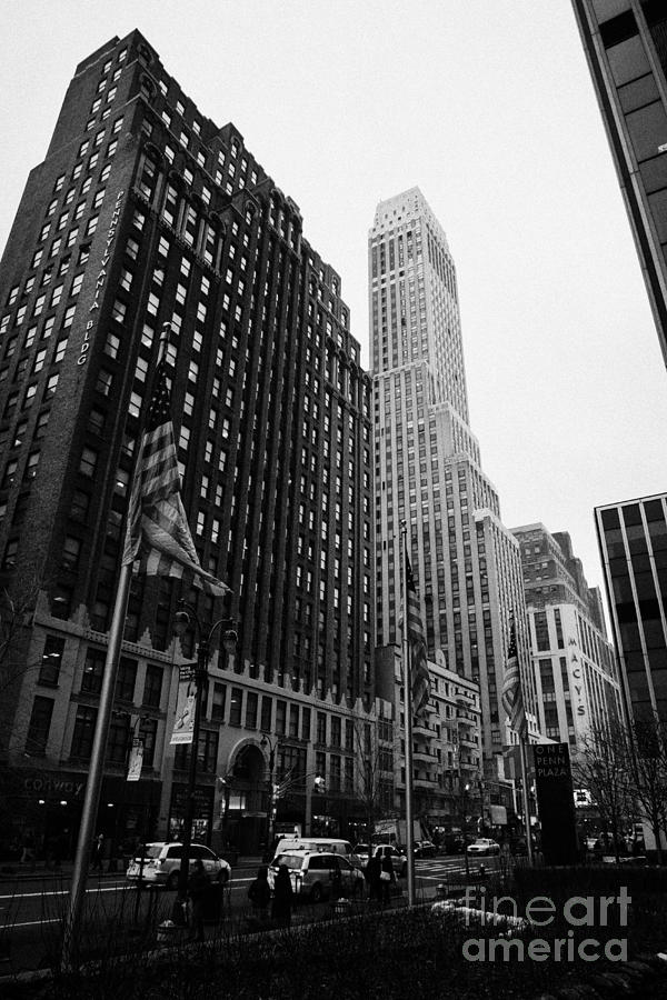 Usa Photograph - view of pennsylvania bldg nelson tower and US flags flying on 34th street from 1 penn plaza by Joe Fox