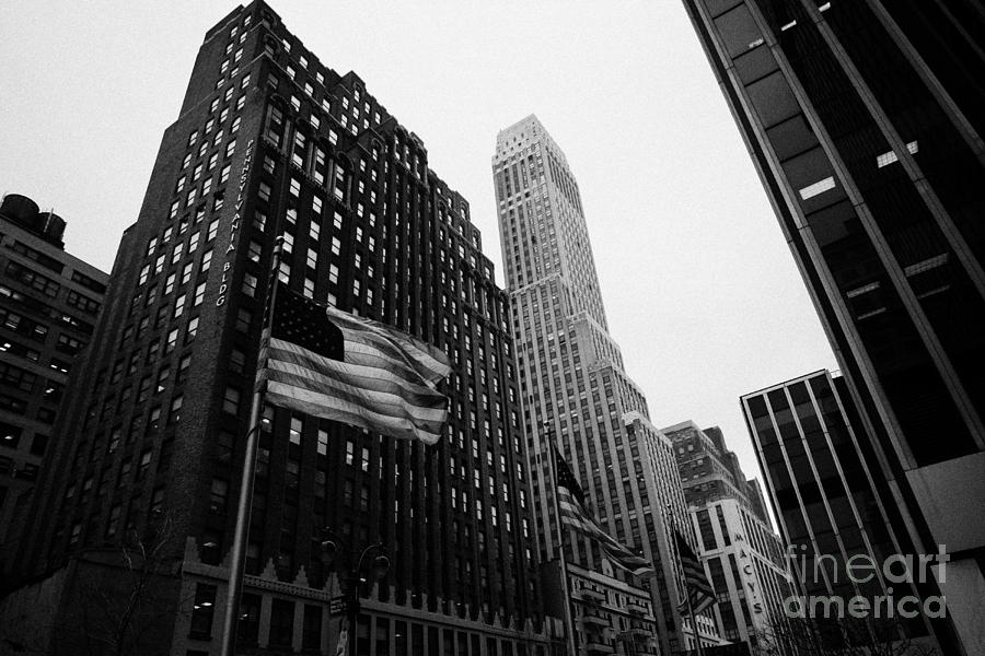 Usa Photograph - view of pennsylvania bldg nelson tower and US flags flying on 34th street from 1 penn plaza nyc by Joe Fox