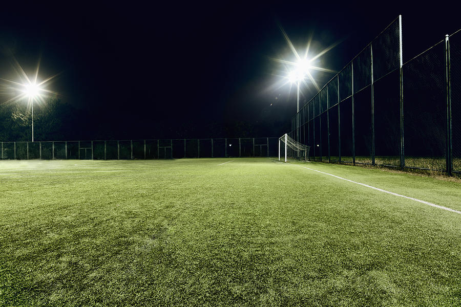 View of soccer field illuminated at night Photograph by FangXiaNuo