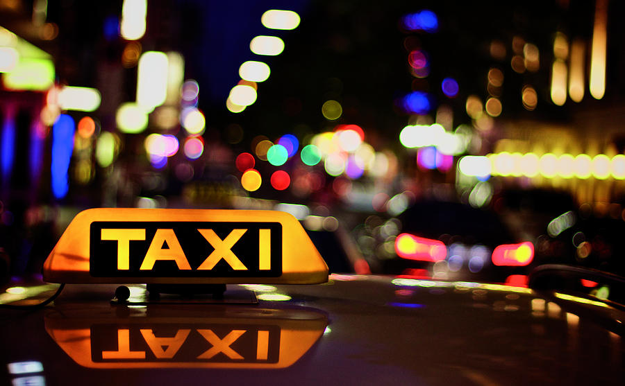 View Of Taxi Board Photograph by Thomas Bonfert