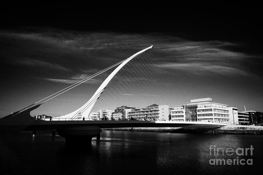 View Photograph - View Of The Samuel Beckett Bridge Over The River Liffey Dublin Republic Of Ireland by Joe Fox