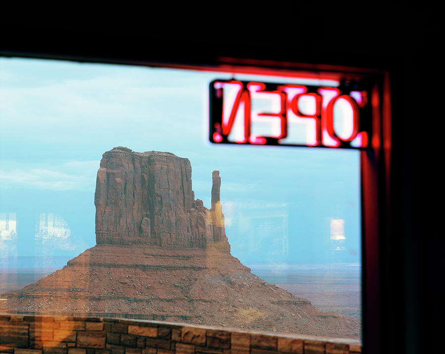View Om Monument Valley Scene Through Photograph by Gary Yeowell