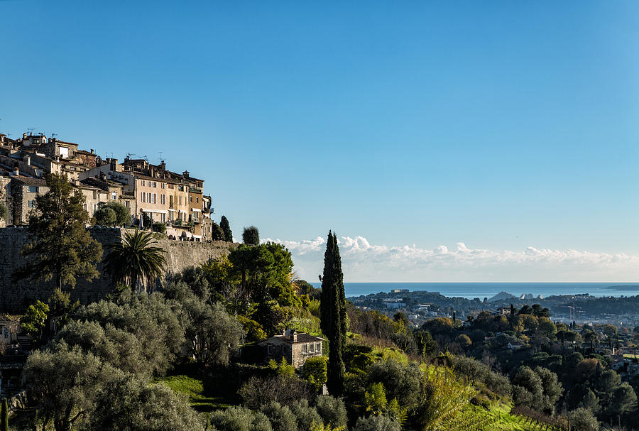 Village on a hill in front of the sea Photograph by Jean-Marc PAYET