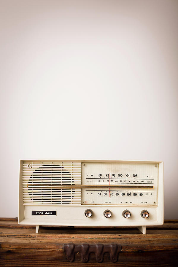 Vintage Beige Radio Sitting On Wood Photograph by Ideabug