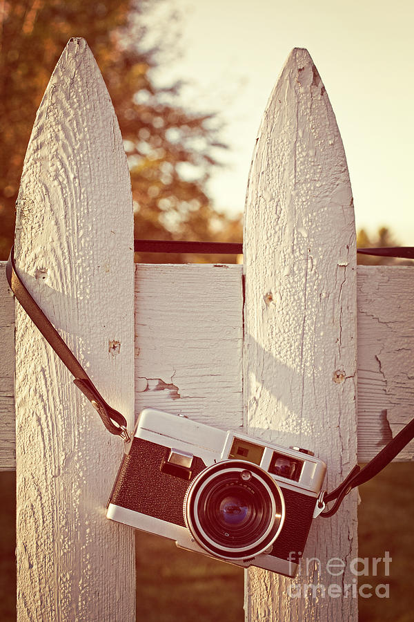 Sunrise Photograph - Vintage Film Camera On Picket Fence by Edward Fielding