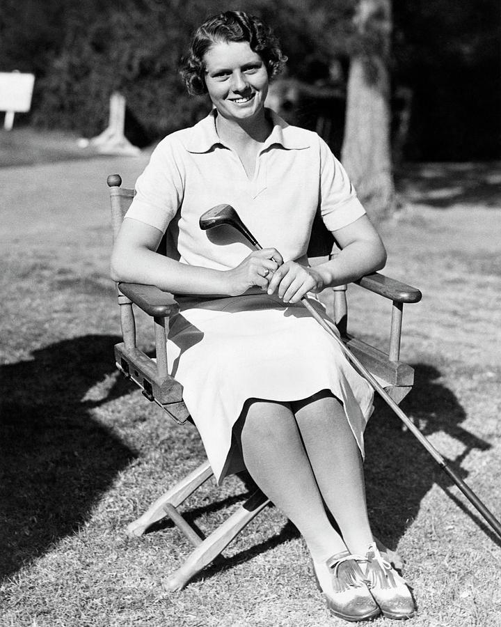 Virginia van wie holding a golf club photograph by acme