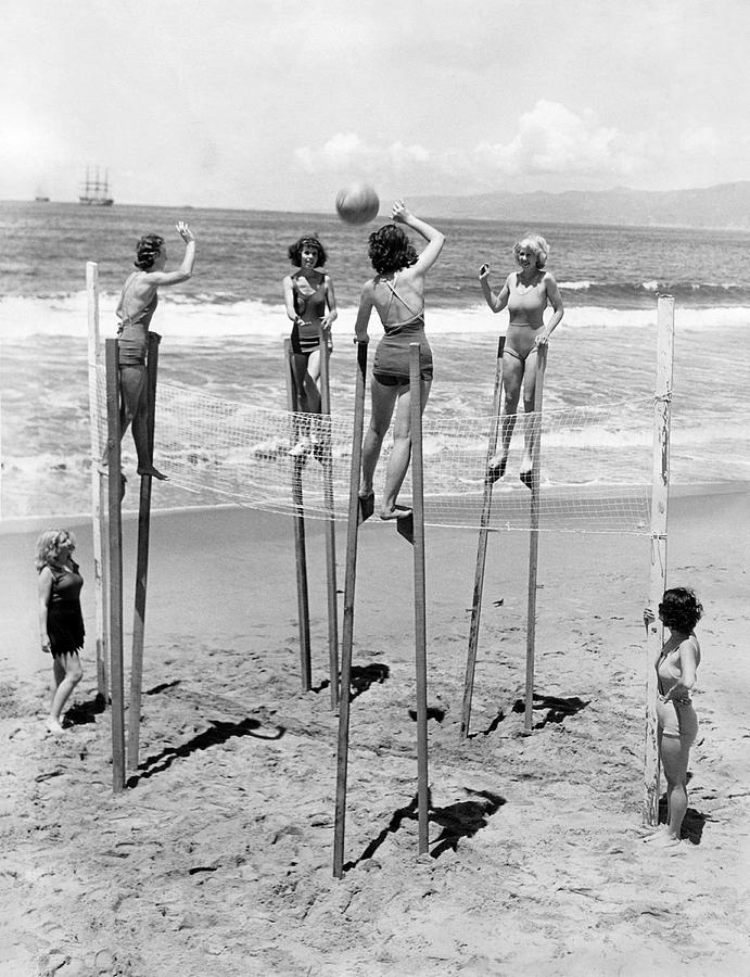 1930's Photograph - Volleyball On Stilts by Underwood Archives