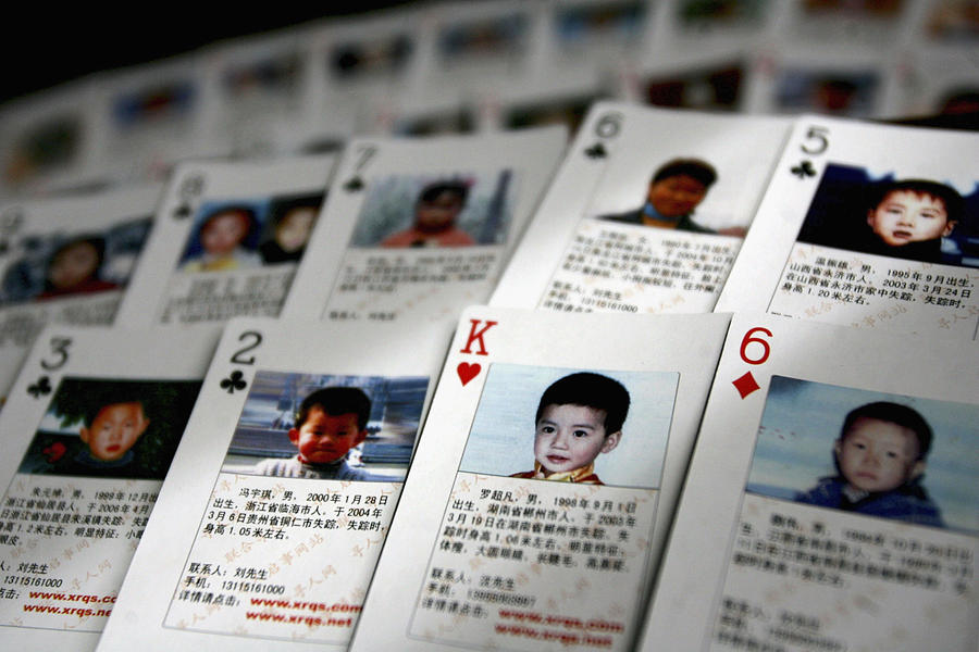 Volunteer Creates Playing Cards To Help Find Missing Children Photograph by China Photos