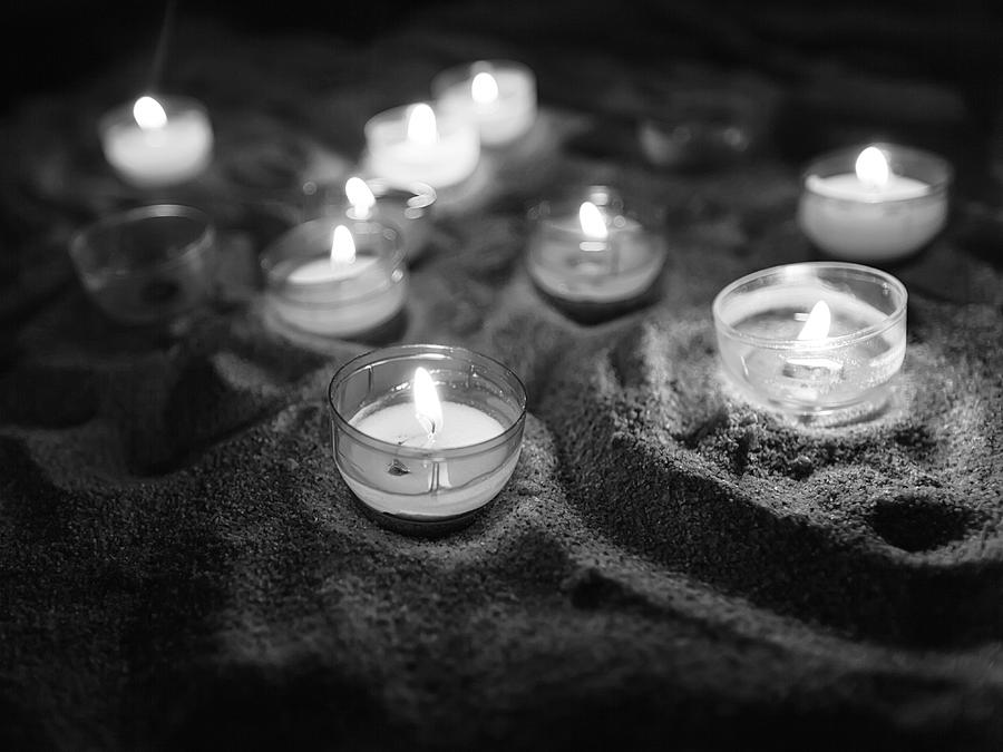 Votive candles in black and white by Charles Lupica