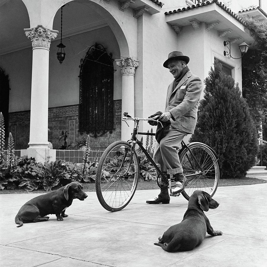 Waldemar Schroder On A Bicycle With Two Dogs Photograph by Luis Lemus