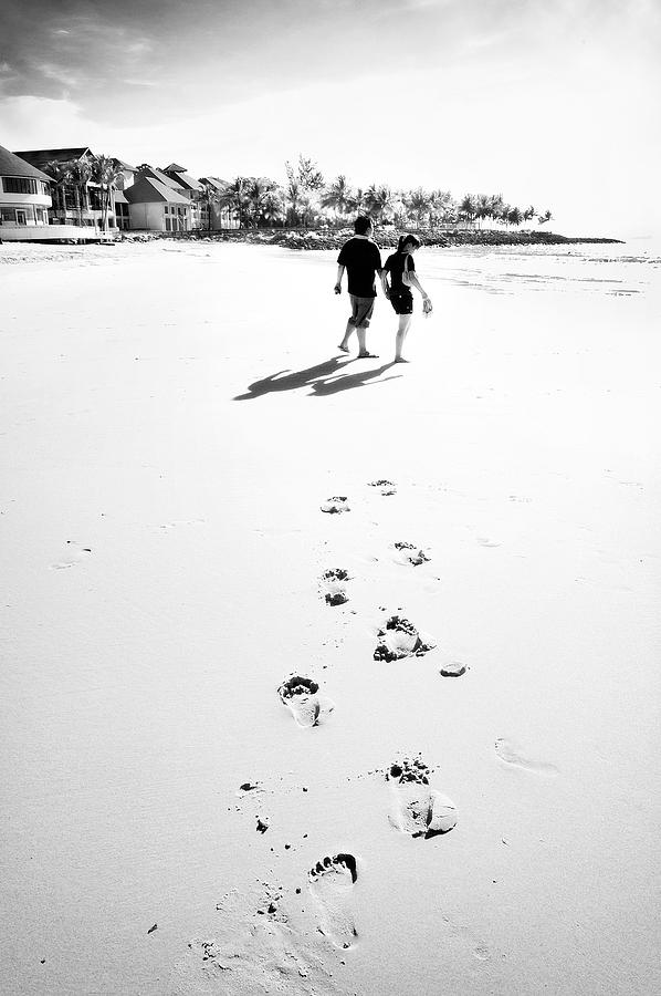 Couple Photograph - Walking In The Beach by William Voon