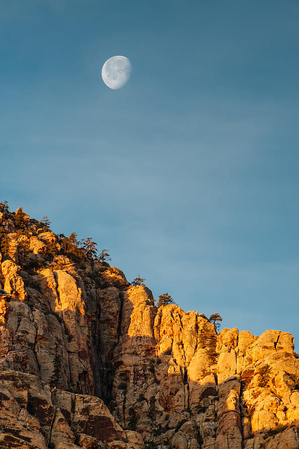 Waning Gibbous Moon Over The Craggy Peaks Of Red Rock Canyon Photograph