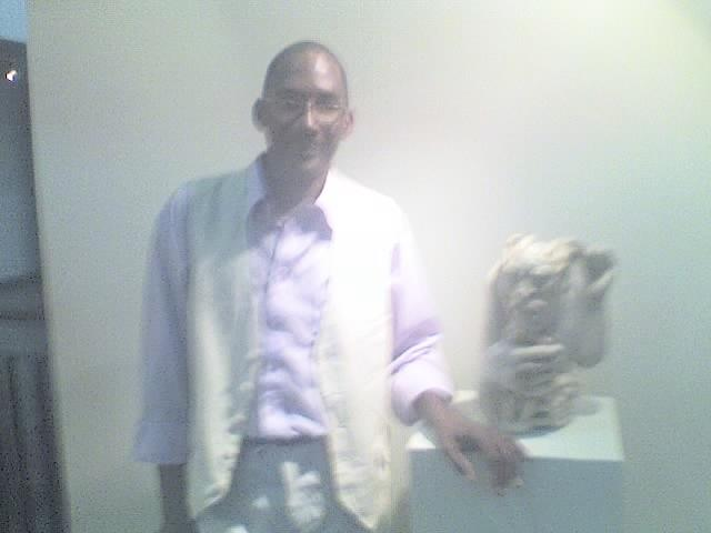 Check Me Out Standing With My Art Work The Official Title Is Want Freedom-stone Sculpture Sculpture - Want Freedom by Peter Johnson
