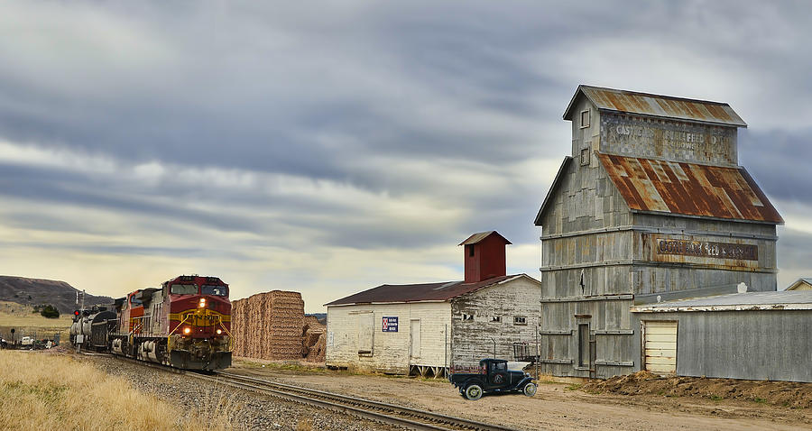 Dash 9 Photograph - Warbonnet Passing The Grain Elevator by Ken Smith