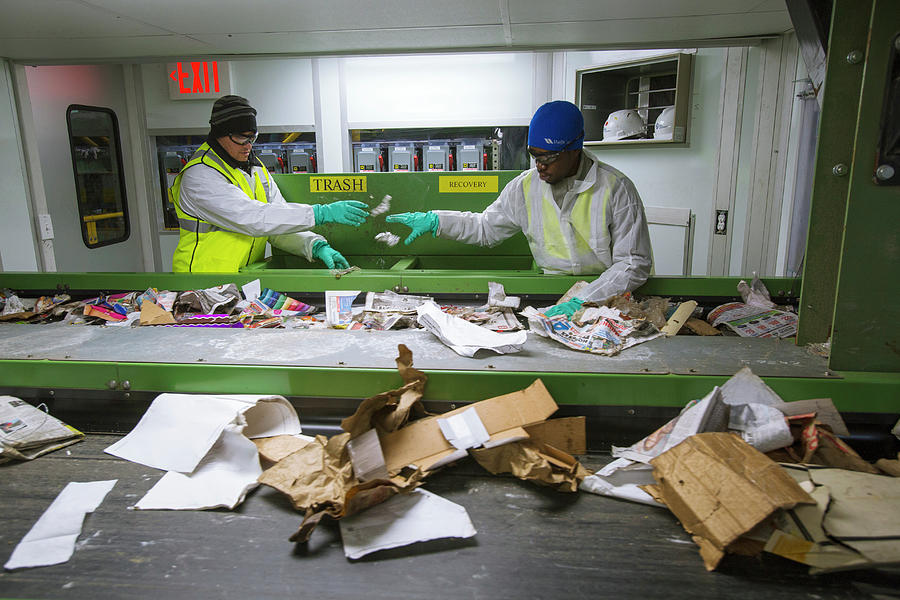 Human Photograph - Waste Sorting At A Recycling Centre by Peter Menzel