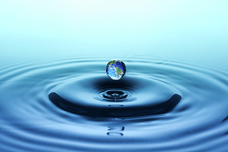 Water Drop With Reflection Of The Globe Photograph by Trout55