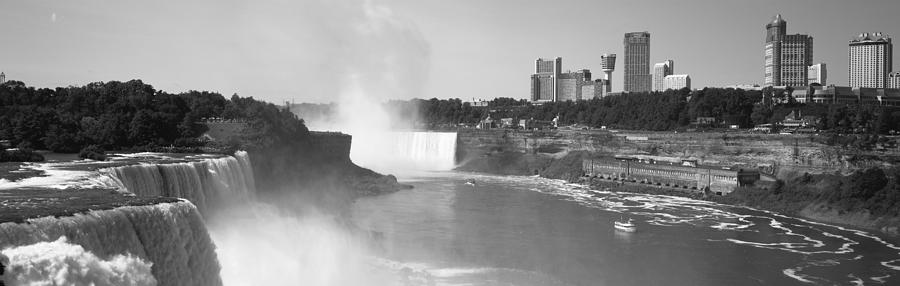 Color Image Photograph - Waterfall With City Skyline by Panoramic Images