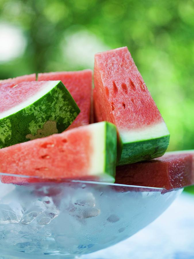 Bowl Photograph - Watermelon Wedges In A Bowl Of Ice Cubes by Foodcollection