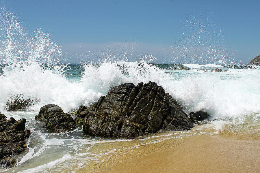 Waves Breaking On The Rocks Photograph by Marc Javelly