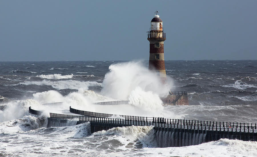 Waves Crashing Into A Lighthouse On The Photograph by John Short / Design Pics