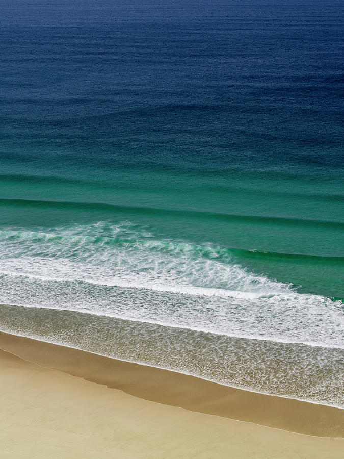 Waves Gently Breaking Ashore On A Sandy Photograph by Doug Armand