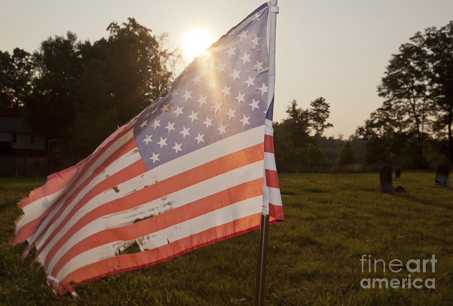 Cemetery Photograph - Weatherworn American Flag by Jonathan Welch