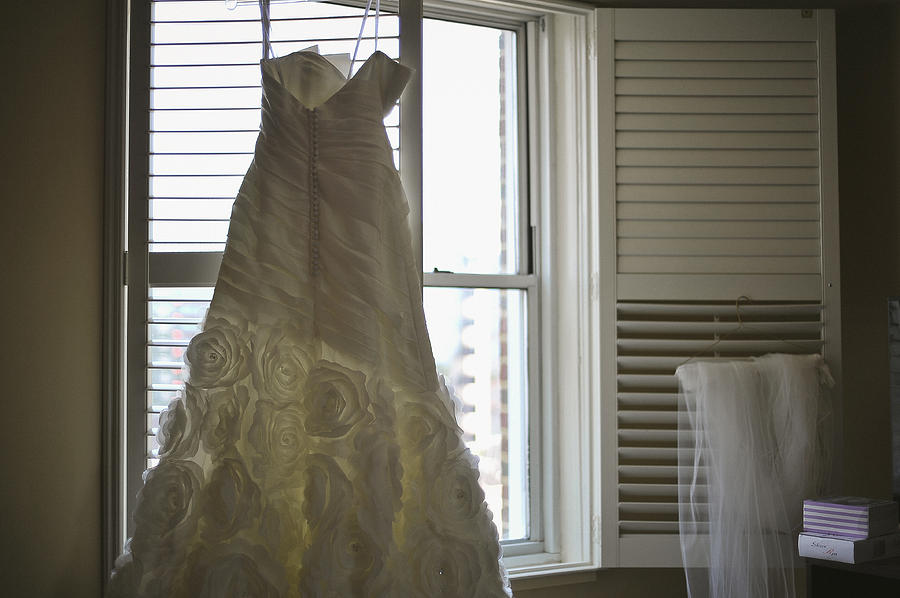 Wedding Dress Photograph - Wedding Dress And Veil By The Window by Mike Hope