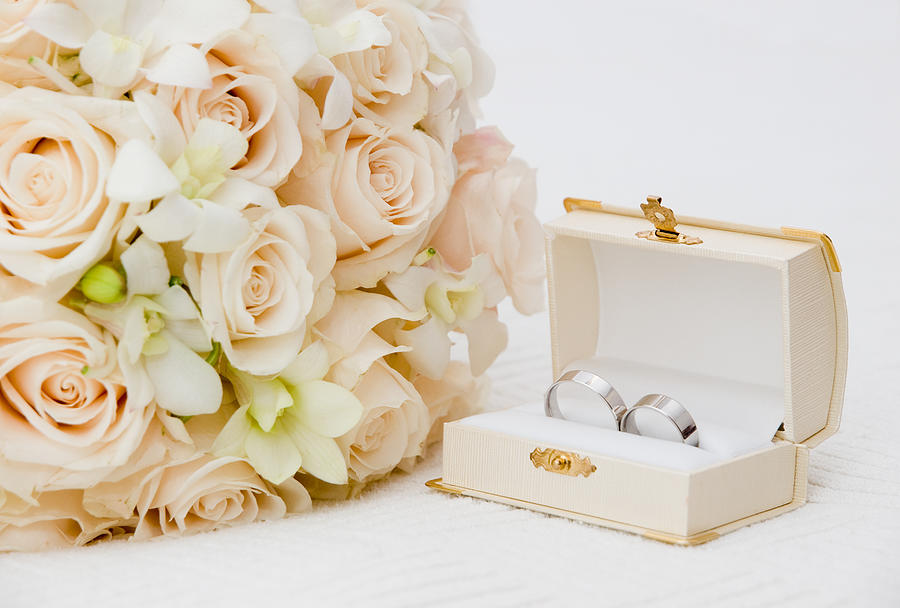 Wedding rings Photograph by Ejla
