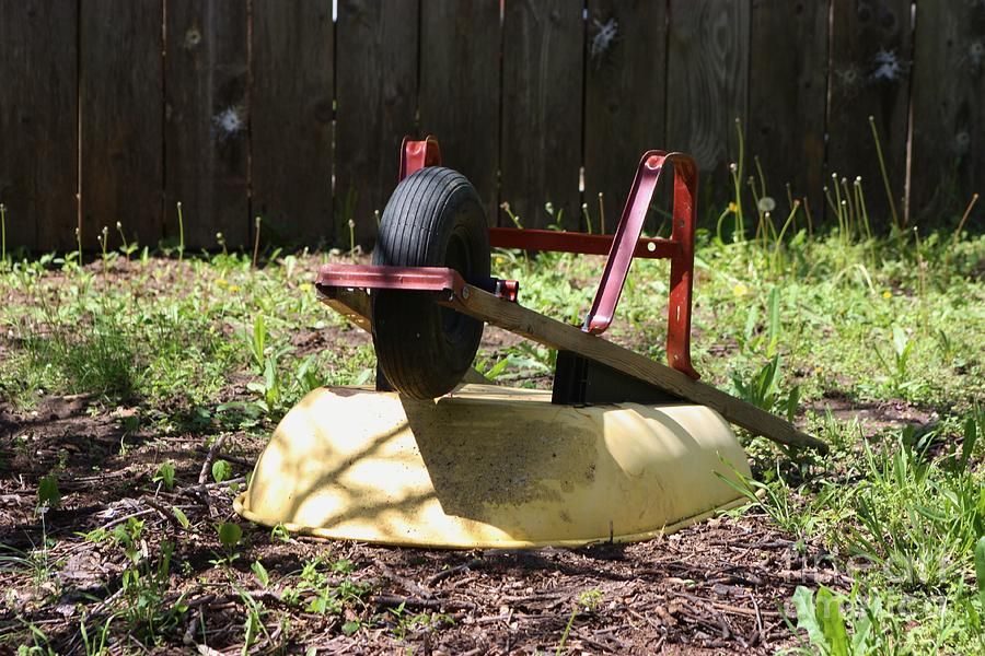 Red Photograph - Wheel Barrow In A Yard by Robert D  Brozek