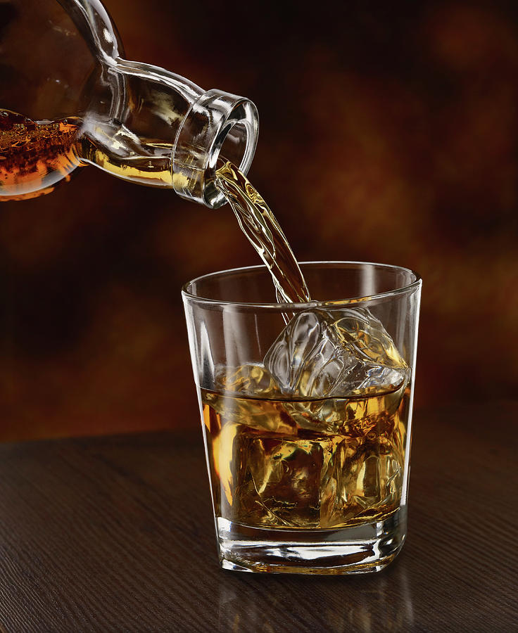 Whisky Being Poured In A Tumbler, Close Photograph by Westend61