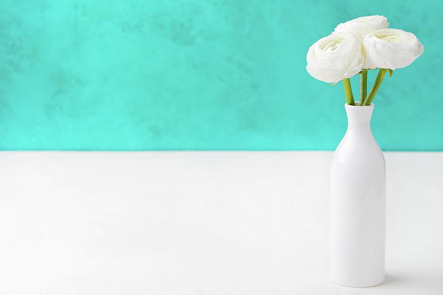 White Ranunculus Flowers In A Ceramic Photograph by Annapustynnikova