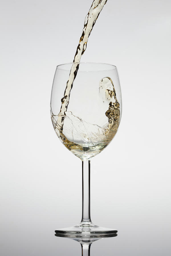White Wine Being Poured Into A Glass Photograph by Dual Dual