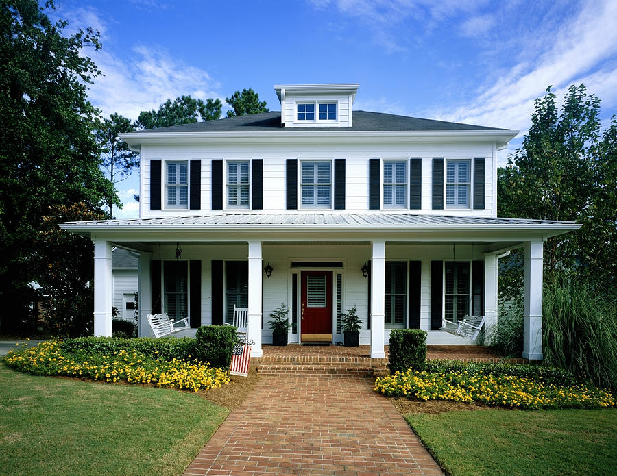 White wooden house, flowers blooming around front porch Photograph by Phillip Spears