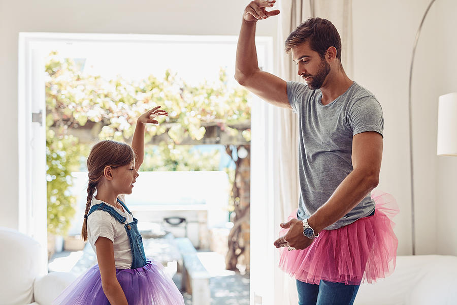Who says dads can't dance? Photograph by PeopleImages