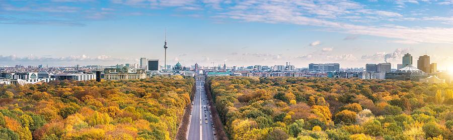 wide Berlin skyline over autumn colored  Tiergarten Photograph by Golero