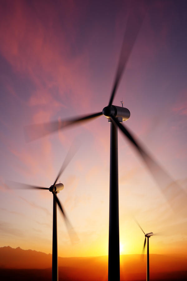 Wind Turbine Blades Spinning At Sunset Photograph