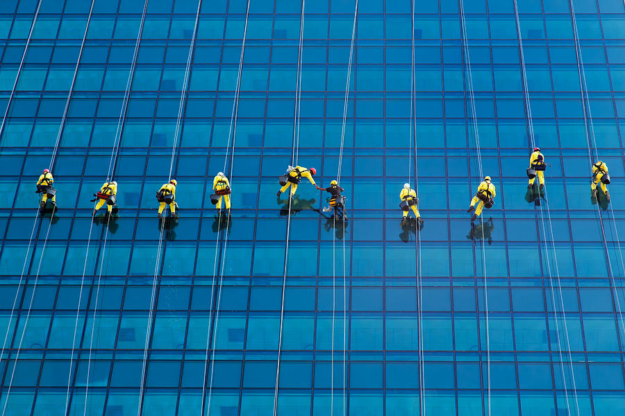 Glass Building Photograph - Window Cleaners by David Van der Want