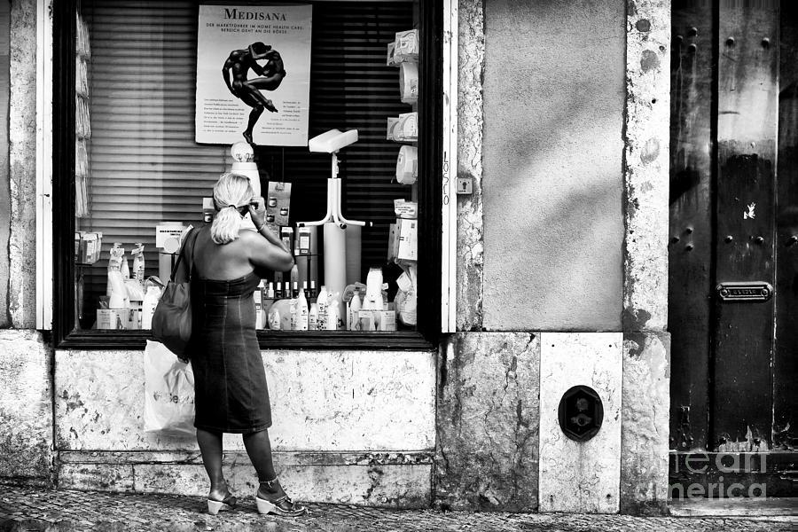 Window Shopping Photograph - Window Shopping In Lisbon by John Rizzuto