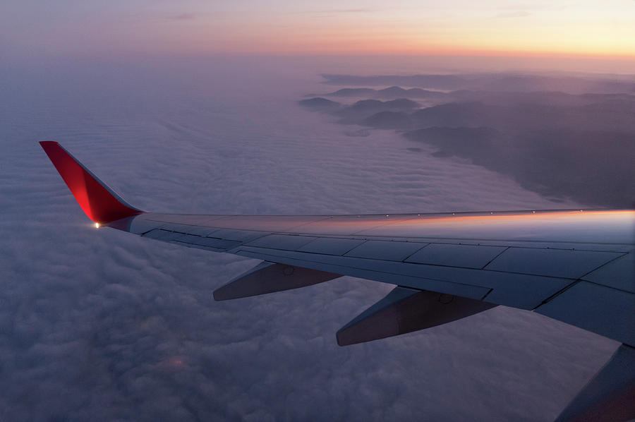 Wing Of An Aeroplane With Sunset Photograph by Rotofrank