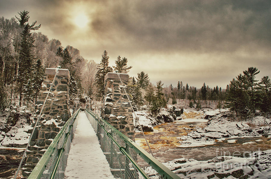 Jay Cooke Photograph - Winter Sunrise Over A Swinging Bridge by Ever-Curious Photography
