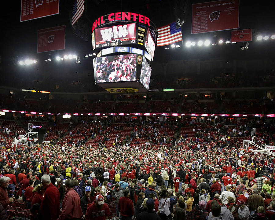 Madison Photograph - Wisconsin Fans Rush The Court At The Kohl Center by Replay Photos