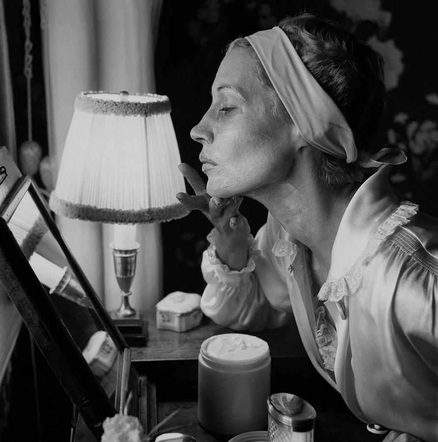 Woman Applying Face Cream Photograph by Frances McLaughlin-Gill
